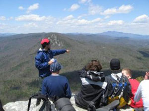 students and instructor on mountaintop
